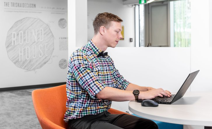 Roundhouse member working at a moveable community desk